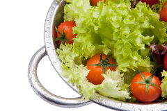Washed fresh cherry tomatoes with salad. Washed fresh tomatoes with salad in colander Royalty Free Stock Image