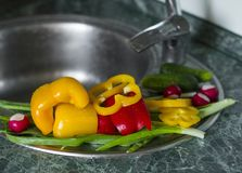 Washed fresh vegetables lie on the kitchen sink Stock Photos
