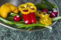 Washed fresh vegetables lie on the kitchen sink Stock Image