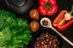 Washed fresh vegetables and spices on a black background. Royalty Free Stock Image