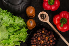Washed fresh vegetables and spices on a black background. Stock Photos