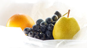 Washed Fruit, Orange, Grapes, Pear. Washed Fruit in a polyethylene. Hygiene Royalty Free Stock Photos