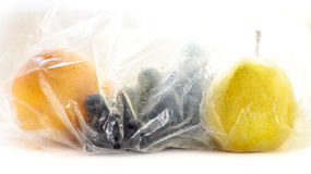 Washed Fruit in Plastic Bags. Orange, Grapes, Pear. Hygiene Royalty Free Stock Photography