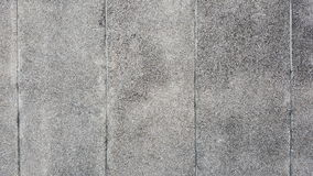 Washed gravel wall finishing. Grey washed gravel wall finishing with vertical groove lines Stock Photo