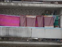 The washed laundry is dried on the balcony of the house. The washed laundry is dried on the balcony royalty free stock image