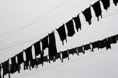 Washed laundry hanging in front of the sky Stock Photography