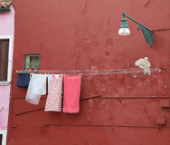 Washed laundry and lots of clothes hung out to dry Stock Photo