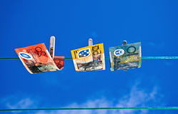 Washed Money 2. Washed money drying on a clothes line Stock Photo