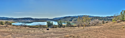 Washed out campsite panoramic. Receded shore of Lake Casitas camp grounds after rain Stock Image