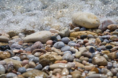 Washed out pebbles. Pebbles washed out by a sea wave stock photography