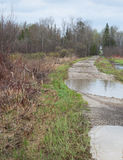 Washed out road. Country road with big potholes Stock Images