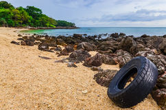 Washed out tyre at beautiful ocean coast in Andaman sea Stock Photos