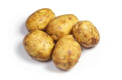 Washed raw potatoes. On a white background close up Royalty Free Stock Photo