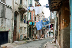 Washed shirts on a rope between old houses of narrow street of Istanbul Stock Photos