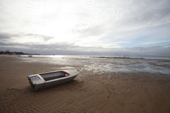 Washed up boat Stock Images