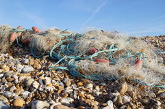Washed Up Nets. Fisherman's nets washed up onto pebble beach Royalty Free Stock Photo