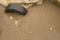 Washed up Tyre on beach Royalty Free Stock Photos