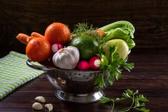 Washed vegetables in a pan on dark background. Rustic Style. Royalty Free Stock Photography