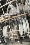 Washer with Clean Dishes. A dishwasher with clean dishes and one empty drawer or shelf Stock Photography