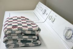 Washer and Dryer. A washer and dryer with folded towels stock photos