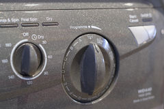 Washer Dryer panel. Detail of washing machine, showing programme selection dial and drying option stock image