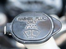 Washer fluid. Symbol of washer fluid.  Close up of black washer fluid inside car engine Royalty Free Stock Images