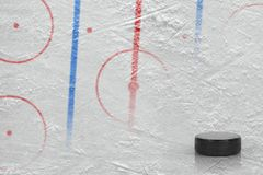 A washer and a fragment of a hockey arena with markings. Puck and hockey arena with markings. Concept, hockey, background stock photo