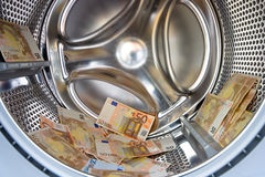 Washer inside with money Royalty Free Stock Photography
