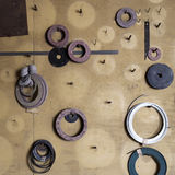 Washers and gaskets on wall Royalty Free Stock Images