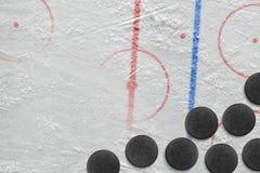 Washers on a hockey rink Stock Photos