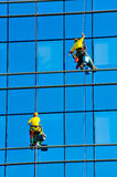 Washers wash the windows of modern skyscraper Royalty Free Stock Images