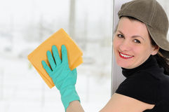 The washerwoman of windows Stock Images