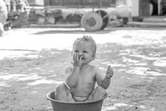 Washes in a basin of water. Girl washes in a basin of water Royalty Free Stock Photos