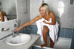 She always washes in cold water Royalty Free Stock Images