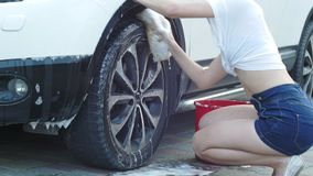 She washes the wheel stock footage