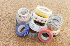 Washi tape. Rolls on a cork surface Stock Photo