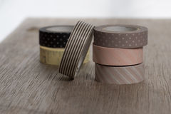 Washi tape rolls on wooden bench. Royalty Free Stock Images