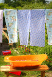Washing. Diaper drying on clothesline on a summer day Stock Photo