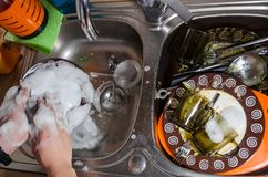 Washing adirty dishes with soap and foam stock image