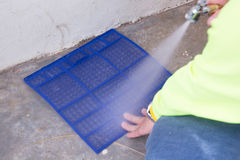 Washing air conditioner filter Royalty Free Stock Photos