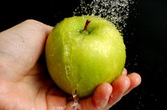 Washing an apple Royalty Free Stock Image