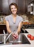 Washing apple Royalty Free Stock Images