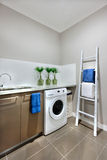 A washing area with a washing machine of a modern house Stock Image