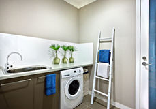 Washing area with a washing machine of a modern house Royalty Free Stock Photo