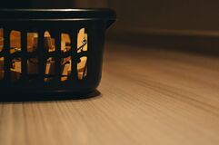 Washing basket on wooden floor