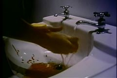 Washing blood off hands in the sink