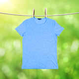 Washing blue tshirt Stock Images