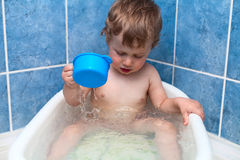 Washing boy. In the shower and bath Royalty Free Stock Photo