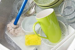 Washing bright dishes Royalty Free Stock Photo