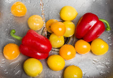 Washing bright fruits and vegetables Royalty Free Stock Photos